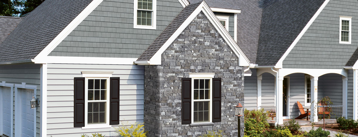 Home Exterior Black Stacked Stone And Blue Siding