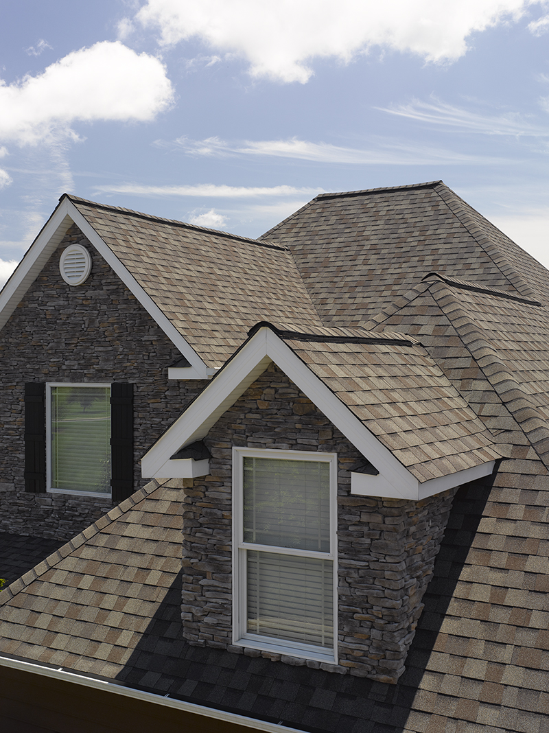 Landmark asphalt shingles in the color Weathered Wood