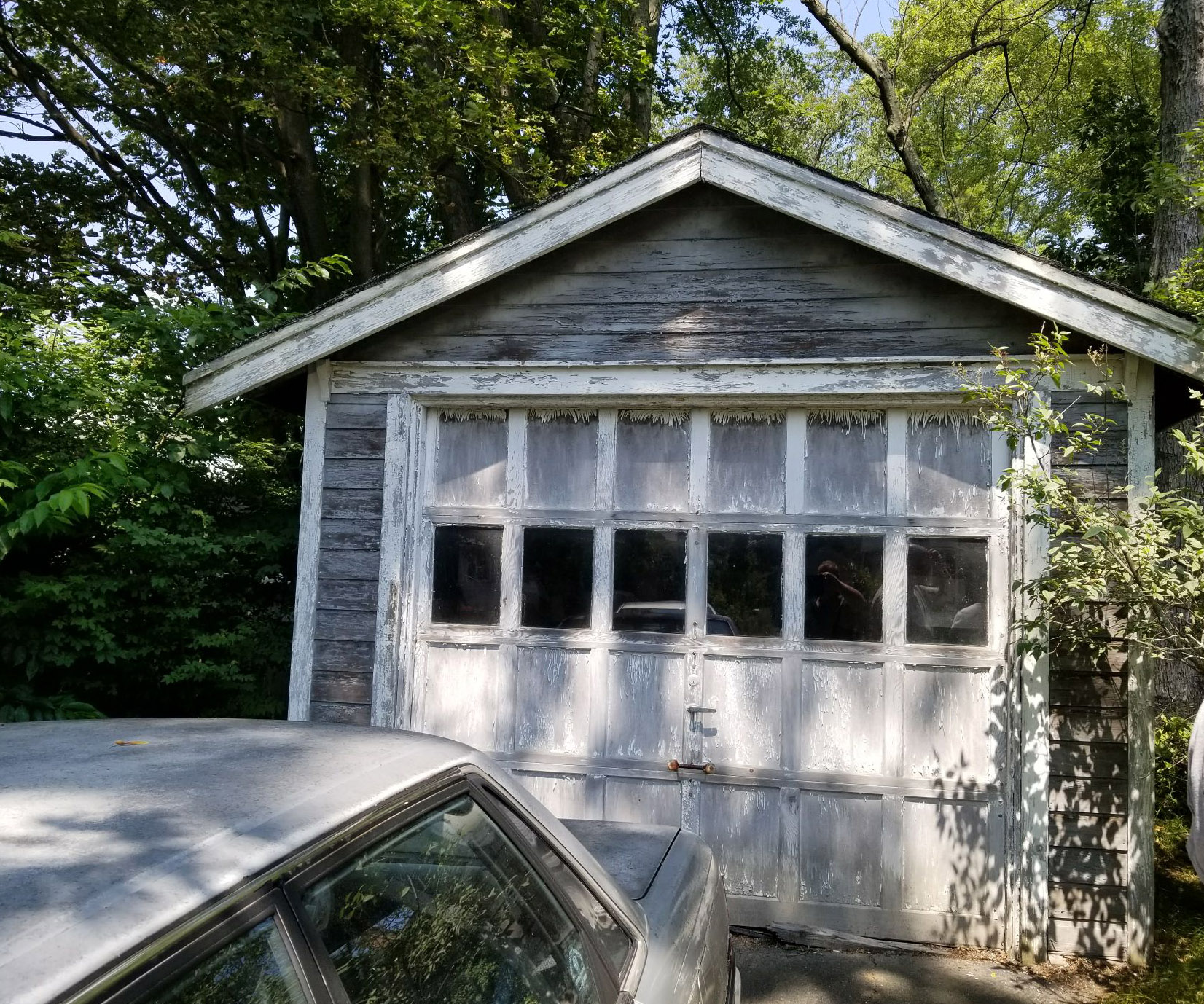Garage exterior makeover - new siding and roof
