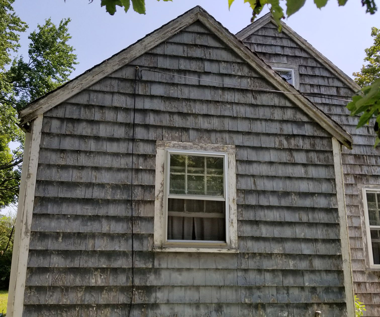 Classic cape code gets new roofing, siding, and trim