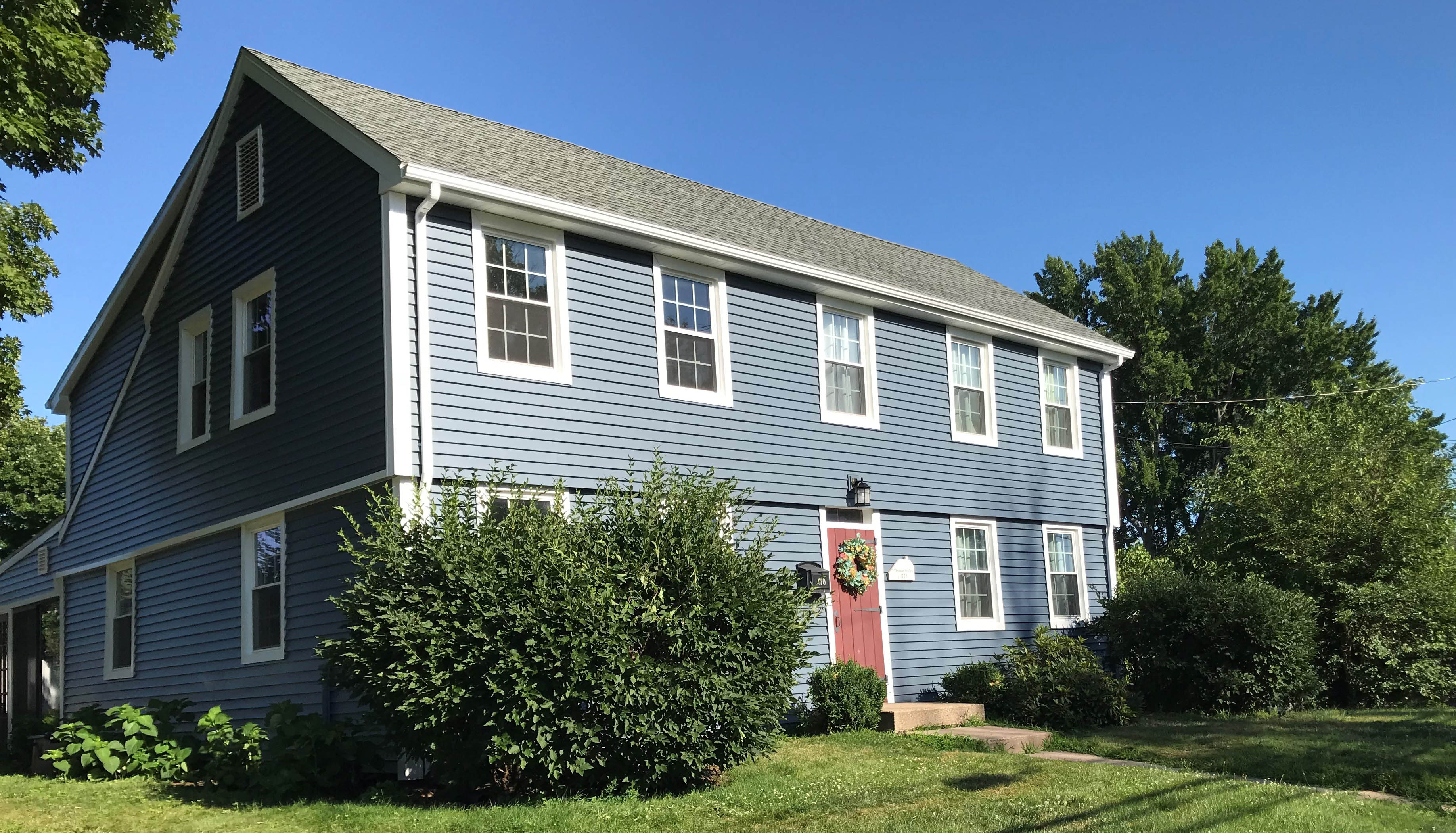 Historic New England saltbox home uses vinyl siding and the results are amazing